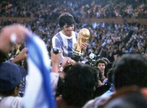 1978 World Cup Final. Buenos Aires, Argentina. 25th June, 1978. Argentina 3 v Holland 1 (aet).    Argentine captain Daniel Passarella holds the World Cup trophy amid chaotic scenes at the end of the match